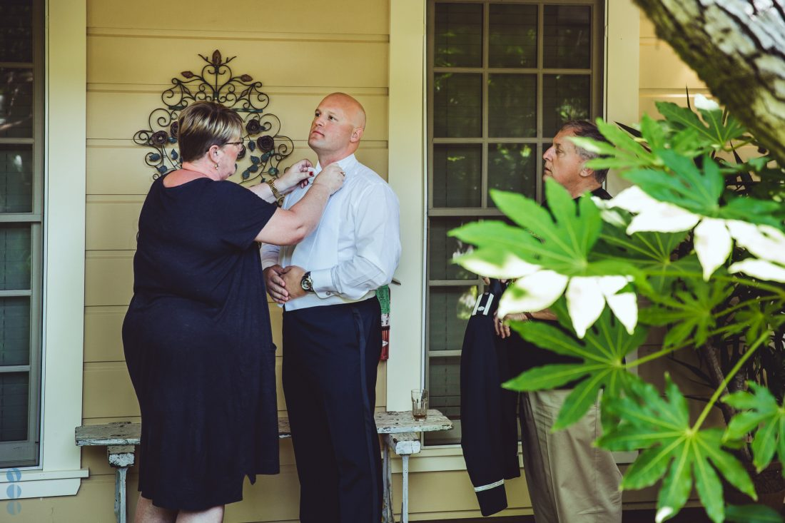 The Groom and his parents in front of the School House Suites at Madrona Manor.