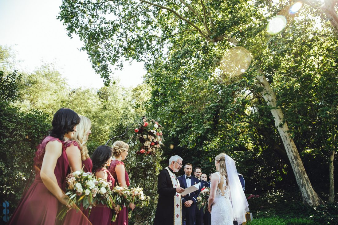 Wedding Photography of the ceremony at Madrona Manor with sun flares. Destination Wedding in Napa Valley.