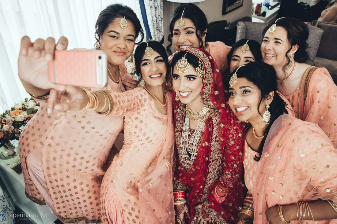Bridesmaids taking a selfie on iPhone with friends