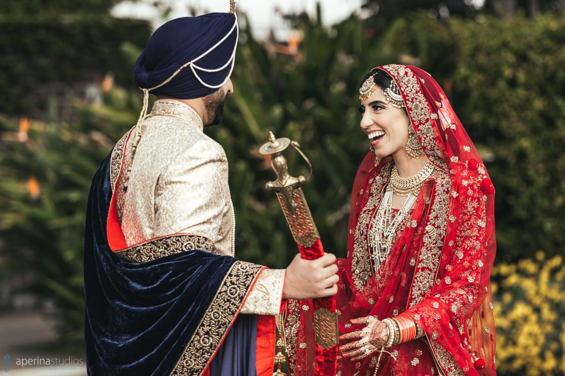 Indian bride in red lehenga and groom first look in a rooftop garden at Fairmont SF