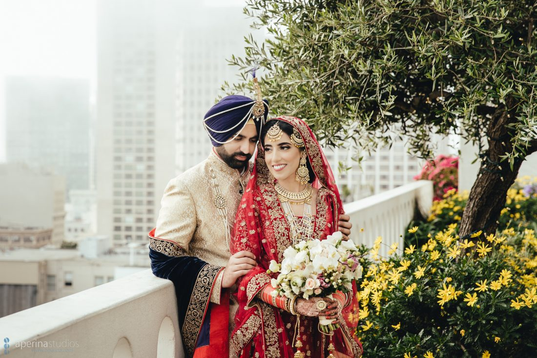 Indian bride in red lehenga and groom portrait on the rooftop of Fairmont San Francisco