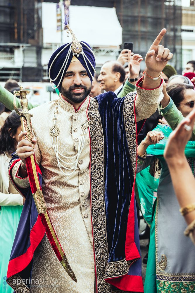 Indian wedding baraat groom dancing on Mason Street in front of Fairmont San Francisco