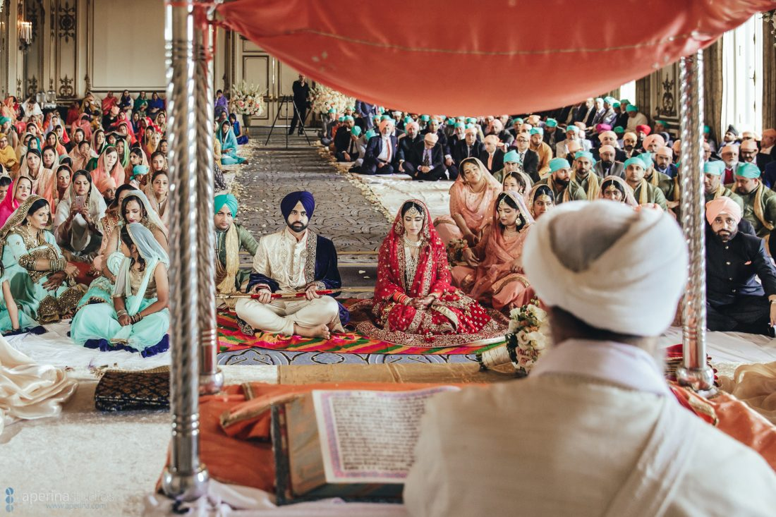 Sikh Indian wedding ceremony of bride and groom in the Gold Room of Fairmont San Francisco
