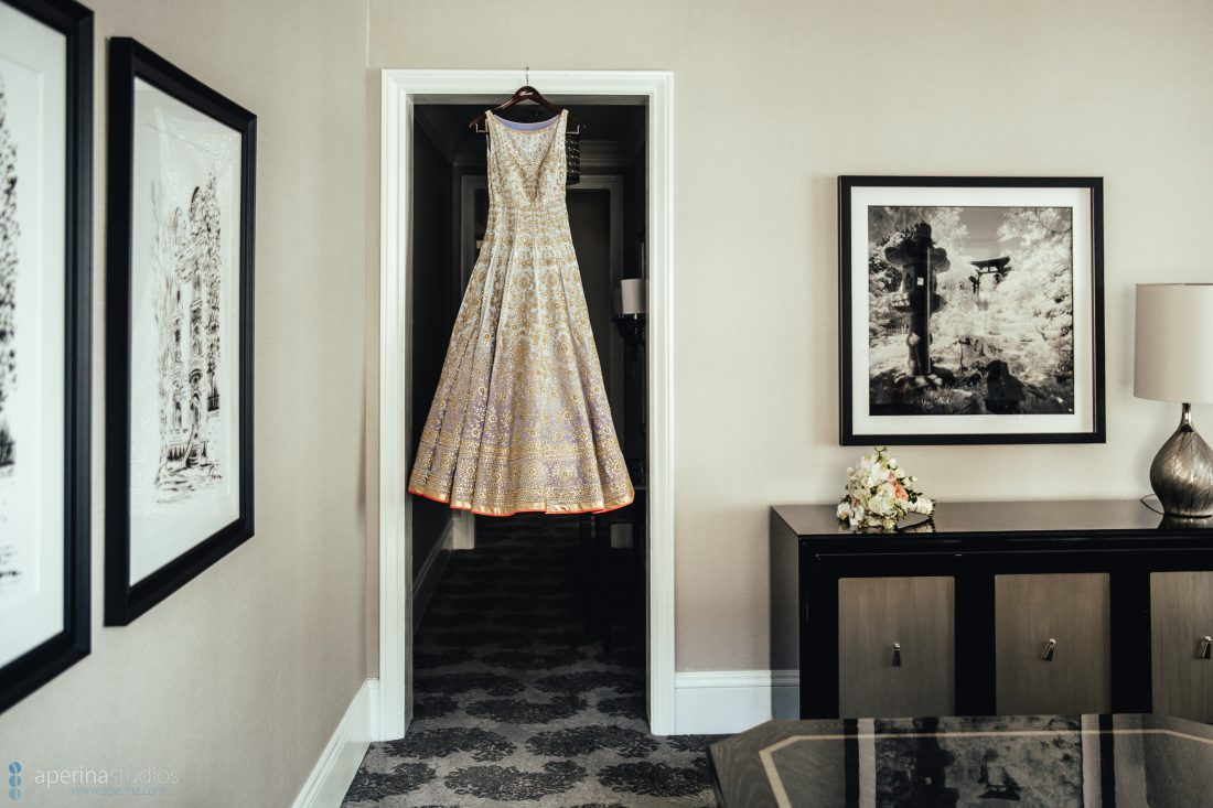 Indian bride Pratap Sons wedding dress hanging in hotel room