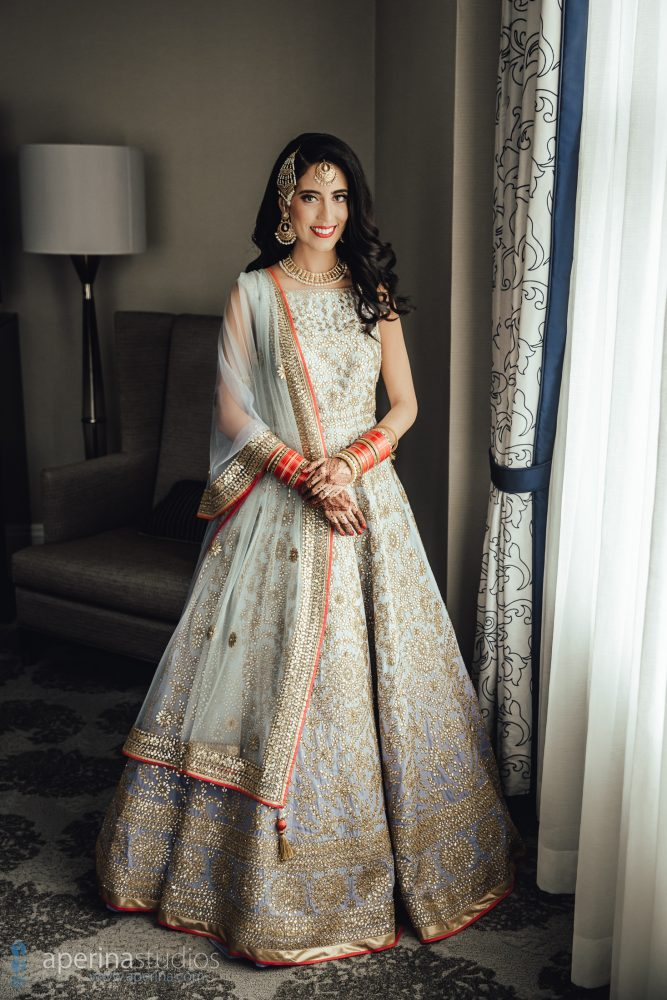 Indian bride model in Pratap Sons wedding dress and gold jewelry
