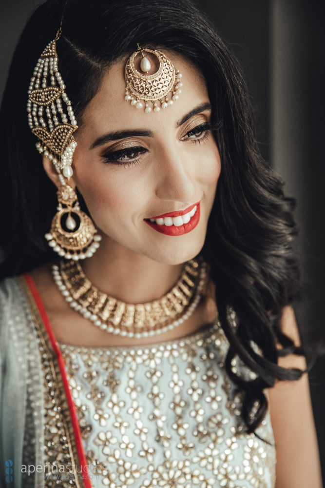 Indian bride model in Pratap Sons wedding dress and gold jewelry with perfect makeup mua