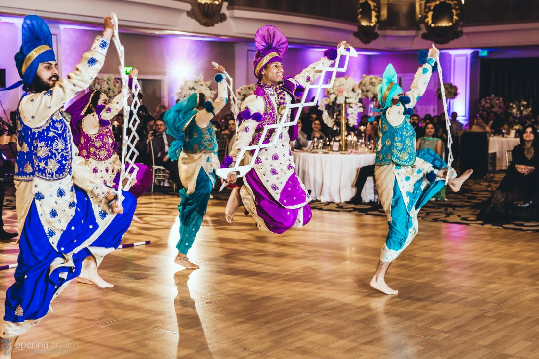 Indian wedding reception dancing performance by Punjabi dance team in the grand ballroom of Fairmont SF