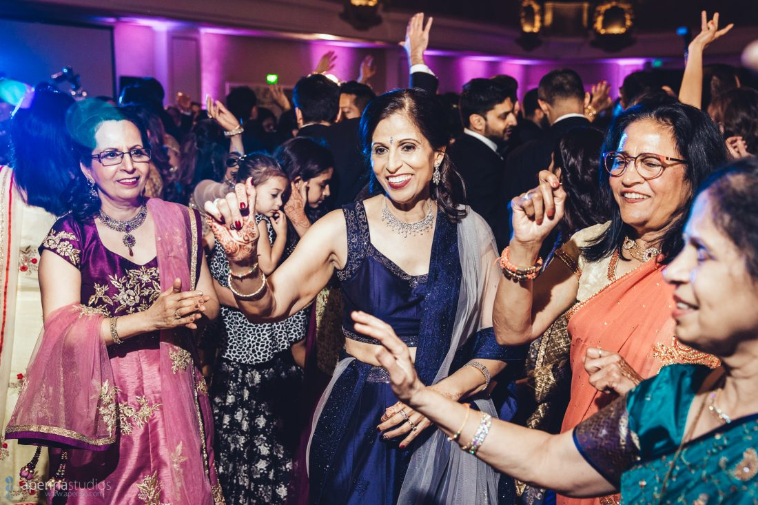 Indian wedding reception dancing moves, party, friends, lights, dj in the grand ballroom of FairmontSF