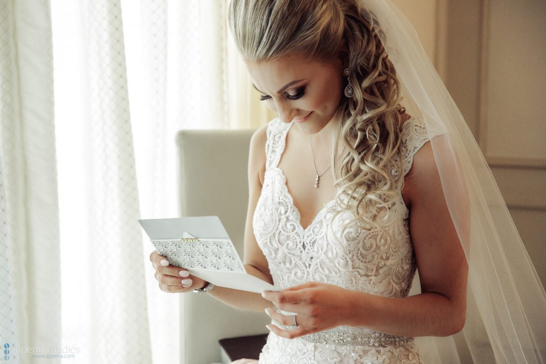 Grace Vineyards Winery Wedding Photos - bride reading note