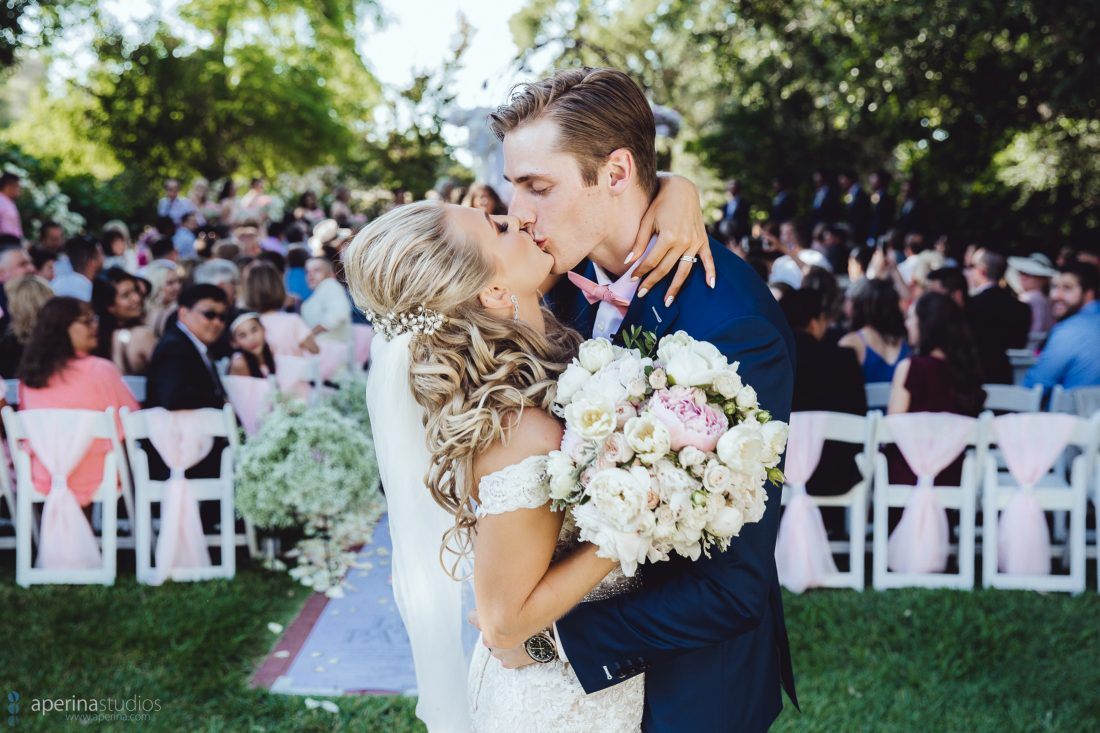 Grace Vineyards Winery Wedding Photographer - Christian Wedding Ceremony kiss