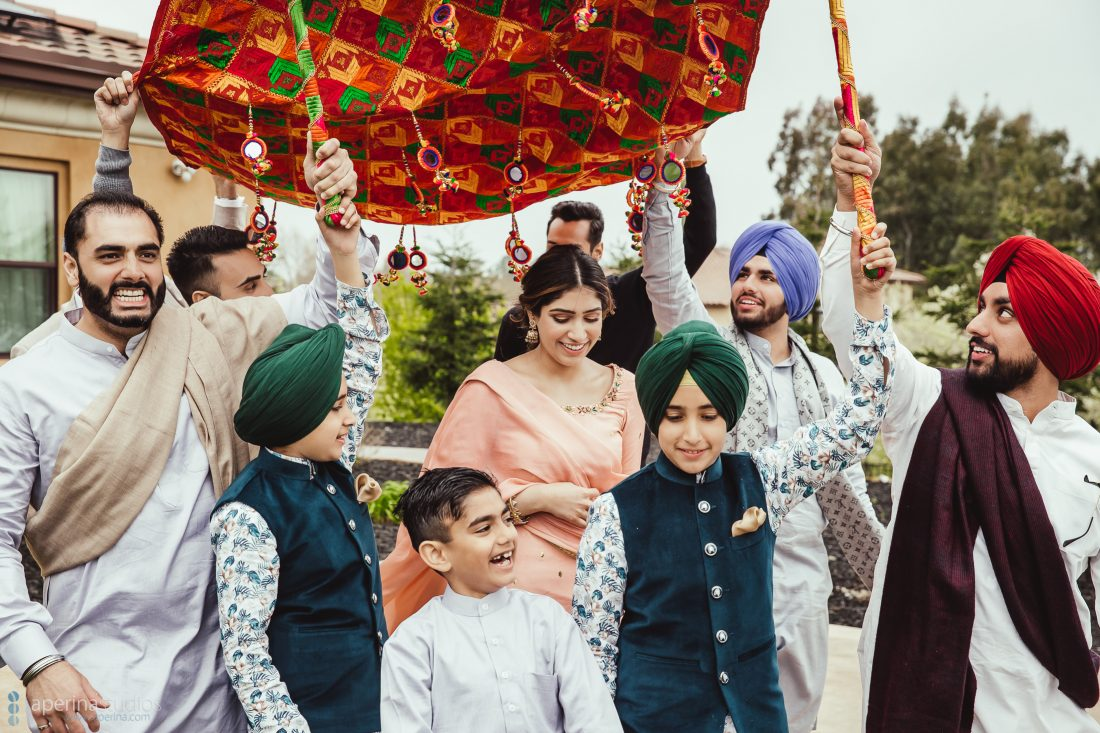 Chunni Ceremony - Bride walking with her family - Wedding Photography
