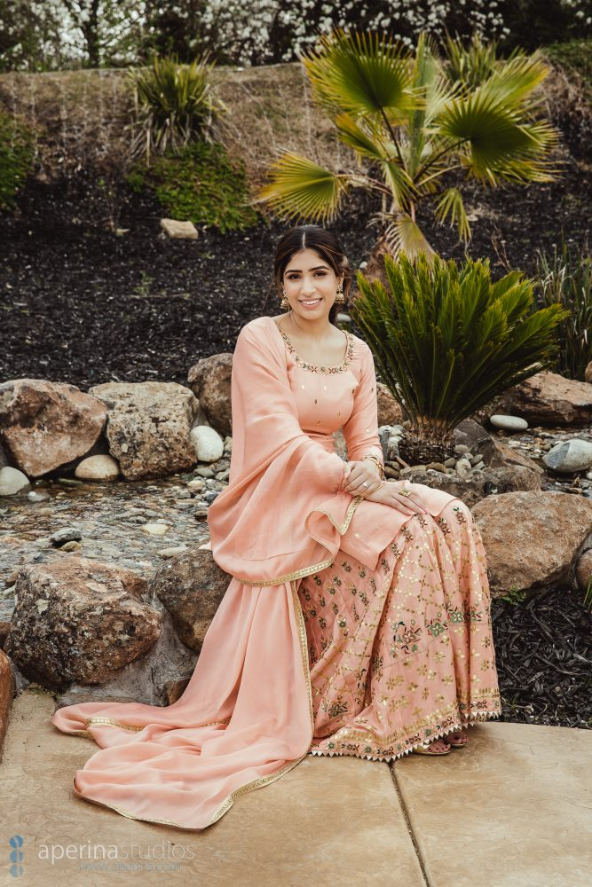 Peach Sharara made by Pleated Couture - golden jhumkis from Talwarsons Jewellers