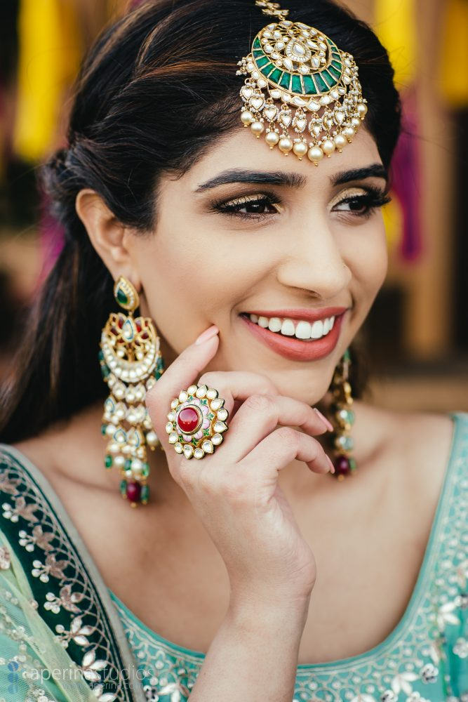 Indian Bride wearing stunning blue and green Anita Dongre lehenga on her Sangeet