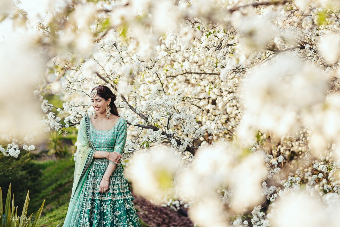Navroop, an Indian Bride wearing stunning blue and green Anita Dongre lehenga on her Sangeet
