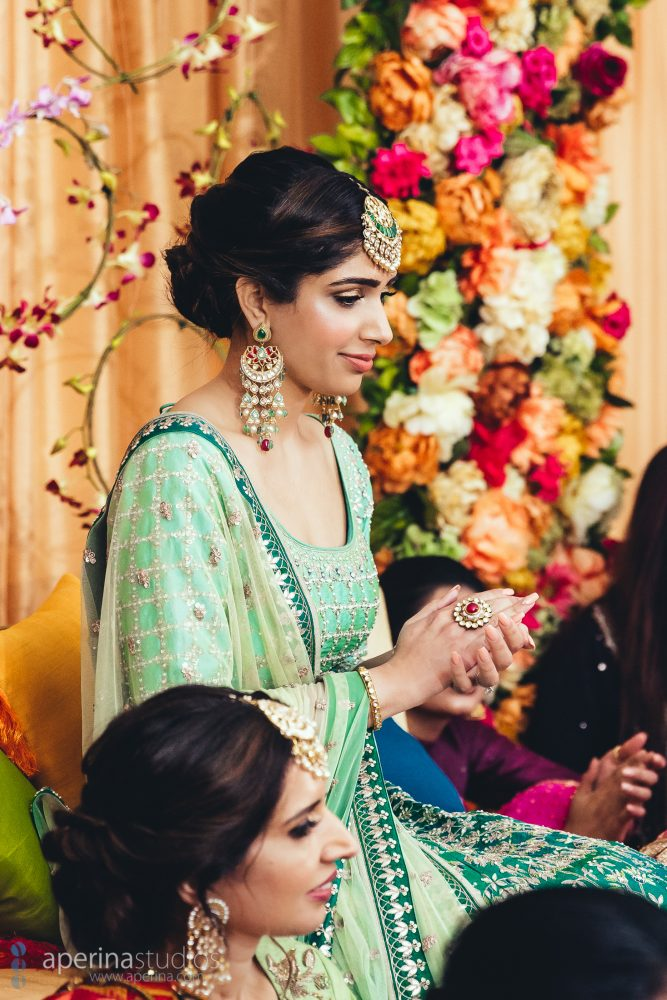 Bride and her family on the wedding Sangeet - Vibrant Tent Sangeet