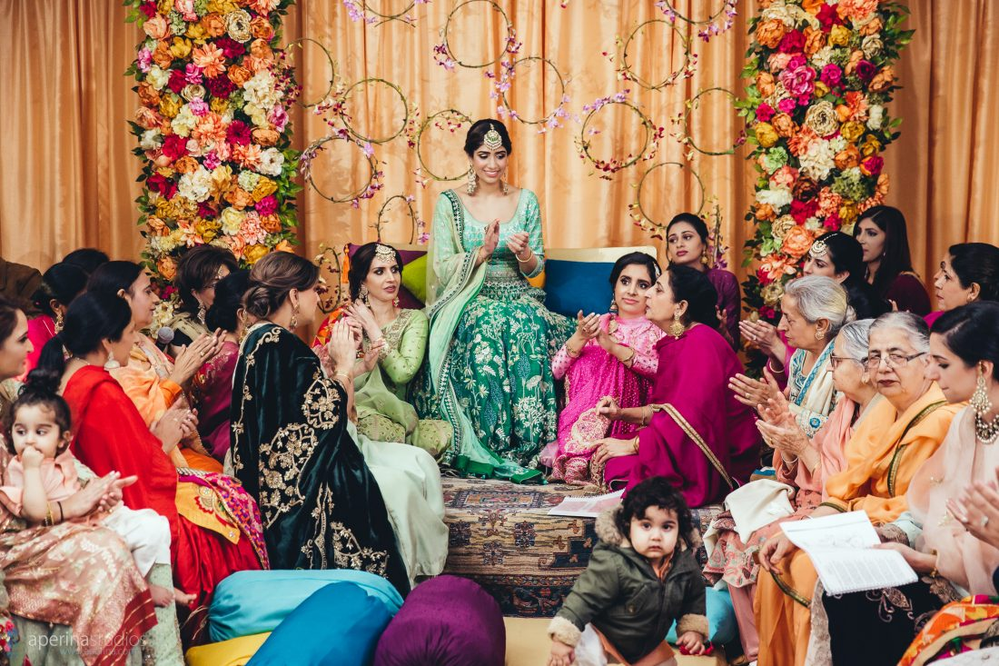 Bride and her family on the wedding Sangeet - Vibrant Tent Sangeet - Indian Wedding Photography