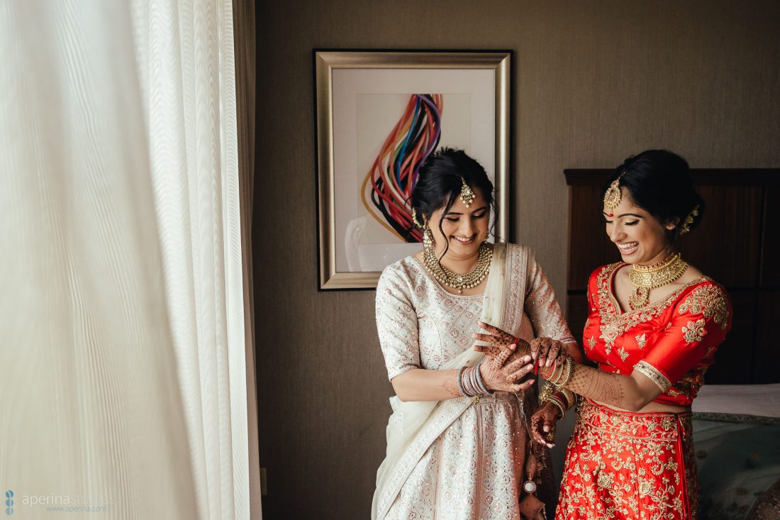 Indian wedding photography - Bride getting ready in red lehenga dress