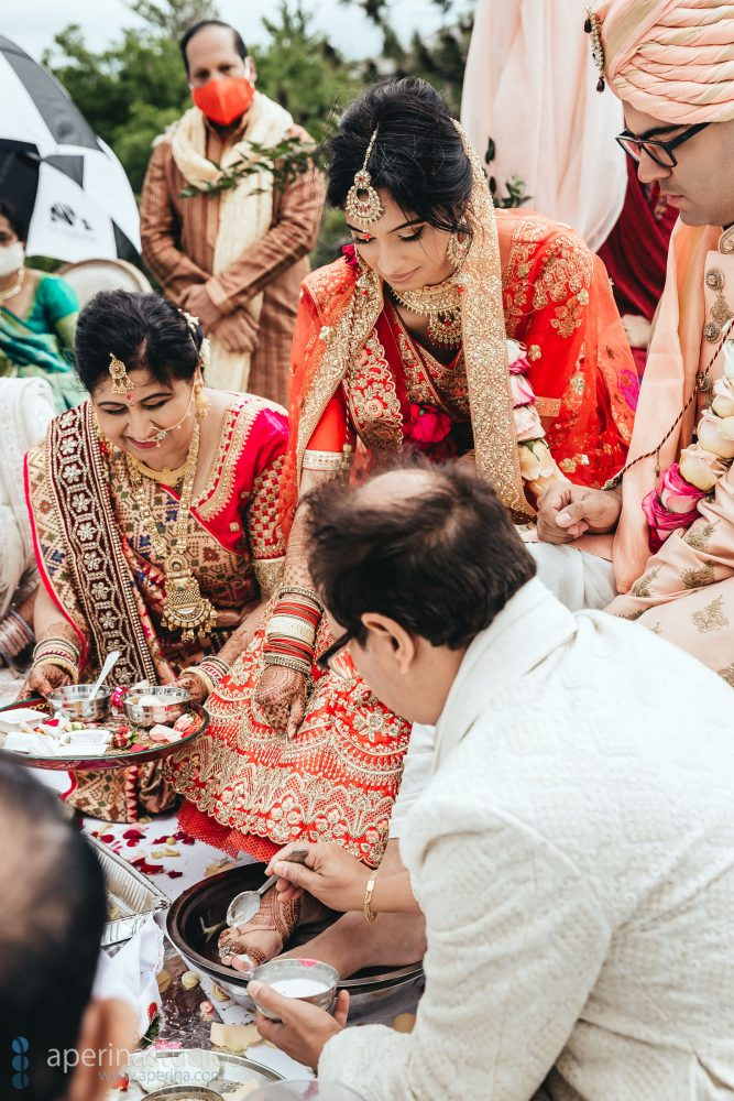 Indian Wedding Photography - beautiful Hindu ceremony with Red, white and pink color scheme.