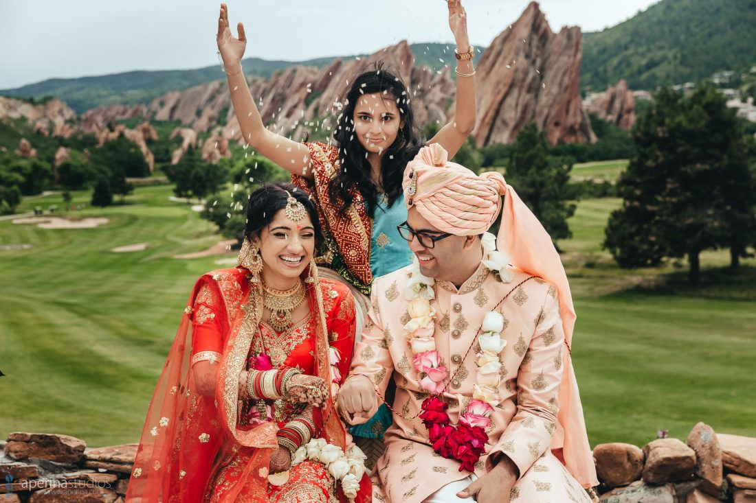 Indian Wedding Photography - beautiful Hindu ceremony rice throwing with Red, white and pink color scheme.
