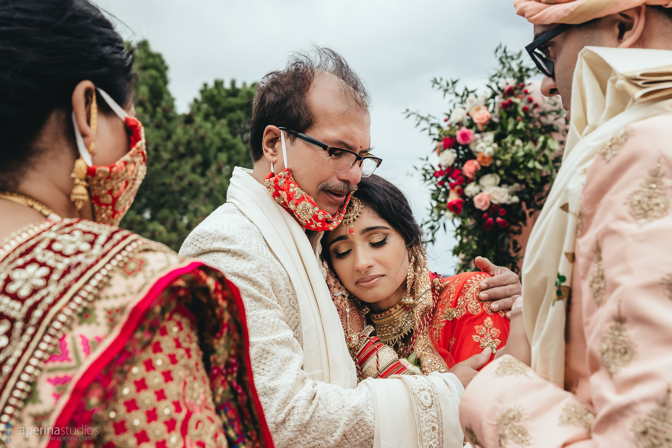 Denver Indian Wedding Photography by Aperina Studios - beautiful Hindu ceremony moments with Red, white and pink color scheme.
