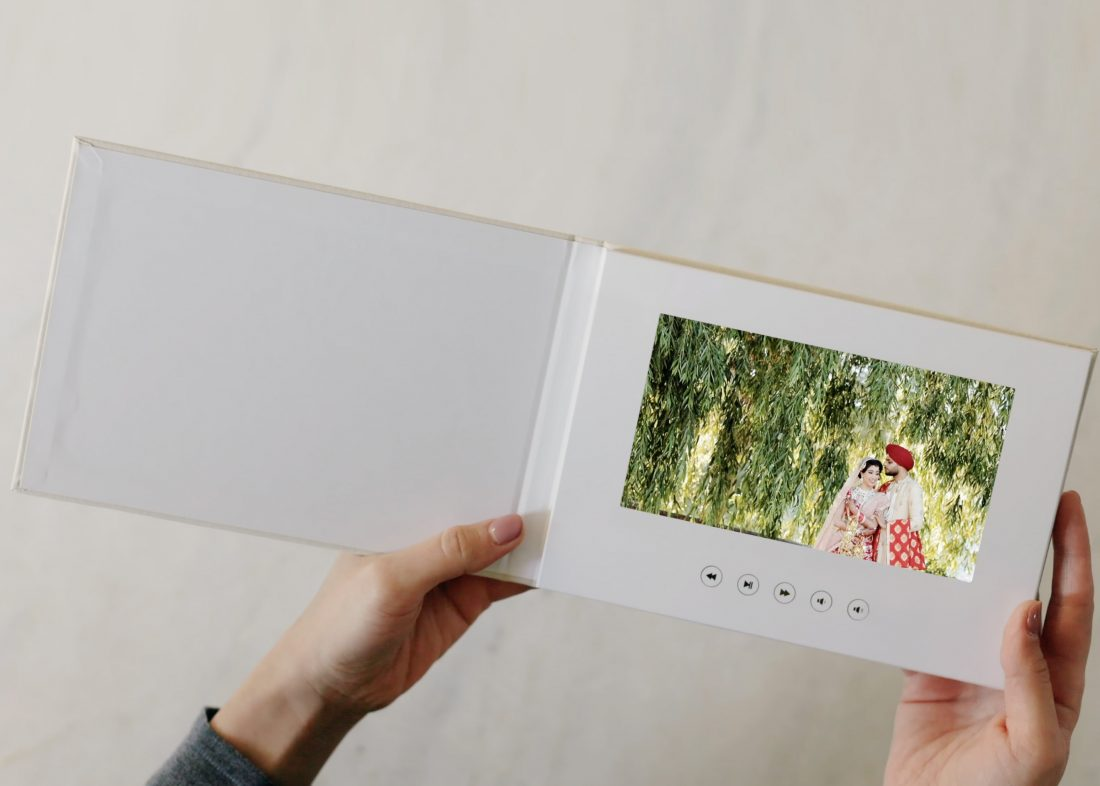 A new way to deliver wedding film - On a wedding video book.